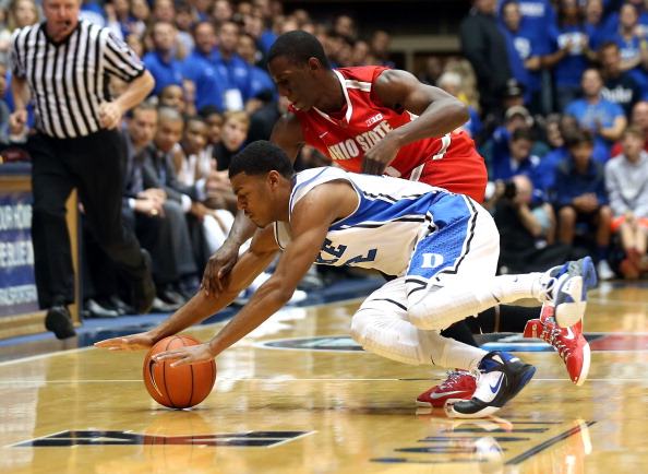 DURHAM, NC - NOVEMBER 28:  Shannon Scott #3 of the Ohio State Buckeyes and Quinn Cook #2 of the Duke Blue Devils dive for a loose ball during their game at Cameron Indoor Stadium on November 28, 2012 in Durham, North Carolina.  (Photo by Streeter Lecka/Getty Images)