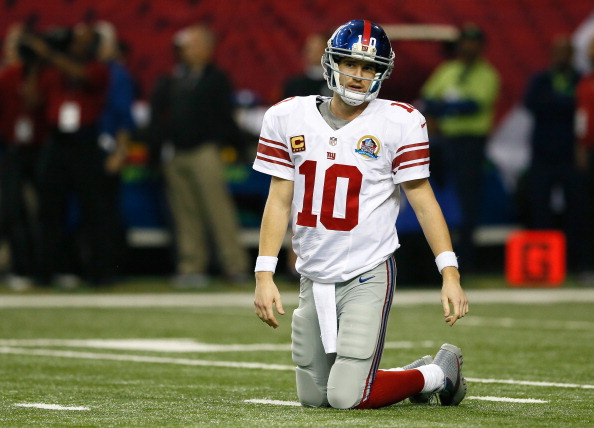 ATLANTA, GA - DECEMBER 16:  Eli Manning #10 of the New York Giants walks off the field after a turnover on downs against the Atlanta Falcons at Georgia Dome on December 16, 2012 in Atlanta, Georgia.  (Photo by Kevin C. Cox/Getty Images)