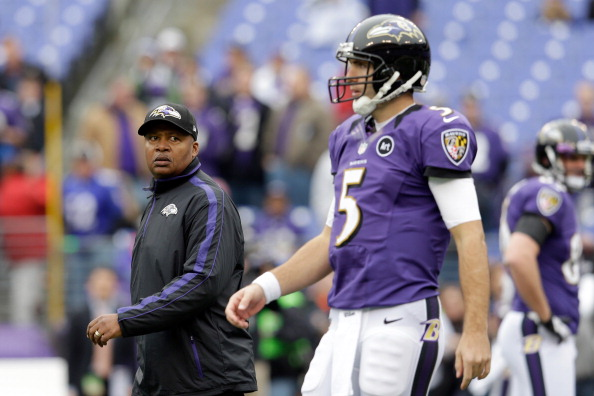 BALTIMORE, MD - DECEMBER 16:  New offensive coordinator Jim Caldwell of the Baltimore Ravens looks on as quarterback Joe Flacco #5 warms up before the start of the Ravens game against the Denver Broncos at M&T Bank Stadium on December 16, 2012 in Baltimore, Maryland.  (Photo by Rob Carr/Getty Images)