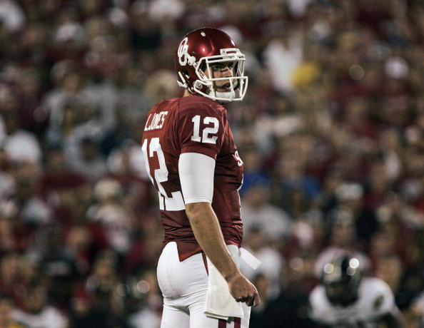 NORMAN, OK - SEPTEMBER 24:  Quarterback Landry Jones #12 of the Oklahoma Sooners looks to the sidelines during the first half of the game against the Missouri Tigers on September 24, 2011 at Gaylord Family-Oklahoma Memorial Stadium in Norman, Oklahoma.  Oklahoma defeated Missouri 38-28.  (Photo by Brett Deering/Getty Images)