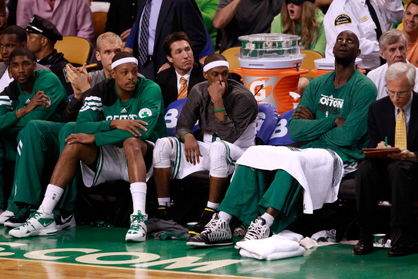 BOSTON, MA - JUNE 07:  Paul Pierce #34, Rajon Rondo #9 and Kevin Garnett #5 of the Boston Celtics look on from the bench late in the fourth quarter against the Miami Heat in Game Six of the Eastern Conference Finals in the 2012 NBA Playoffs on June 7, 2012 at TD Garden in Boston, Massachusetts. NOTE TO USER: User expressly acknowledges and agrees that, by downloading and or using this photograph, User is consenting to the terms and conditions of the Getty Images License Agreement.  (Photo by Jared Wickerham/Getty Images)