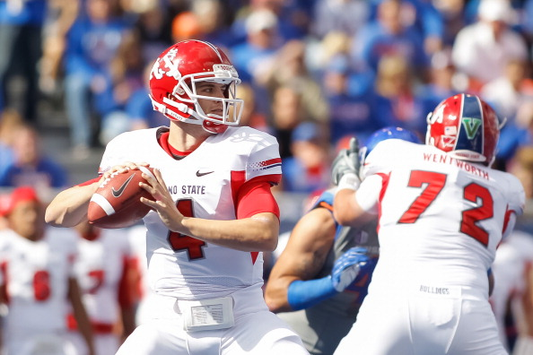 BOISE, ID - OCTOBER 13: Derek Carr #4 of the Fresno State Bulldogs looks for a receiver against the Boise State Broncos at Bronco Stadium on October 13, 2012 in Boise, Idaho.  (Photo by Otto Kitsinger III/Getty Images)