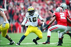 Nov 24, 2012; Columbus, OH, USA; Michigan Wolverines quarterback Denard Robinson (16) runs the ball in the first quarter against the Ohio State Buckeyes at Ohio Stadium. Mandatory Credit: Andrew Weber-USA TODAY Sports