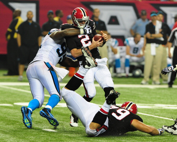 ATLANTA, GA - SEPTEMBER 30: Matt Ryan #2 of the Atlanta Falcons is sacke by Charles Johnson #95 of the Carolina Panthers at the Georgia Dome on September 30, 2012 in Atlanta, Georgia  (Photo by Scott Cunningham/Getty Images)
