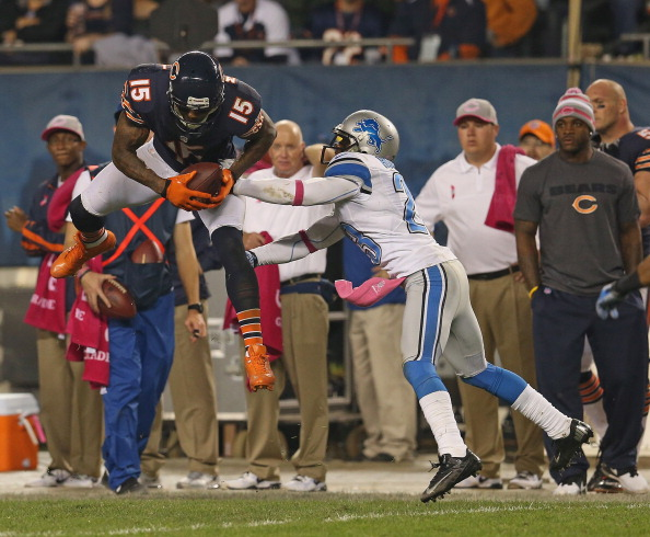 CHICAGO, IL - OCTOBER 22:  Brandon Marshall #15 of the Chicago Bears leaps to make a catch over Chris Houston #23 of the Detroit Lions at Soldier Field on October 22, 2012 in Chicago, Illinois. The Bears defeated the Lions 13-7.  (Photo by Jonathan Daniel/Getty Images)