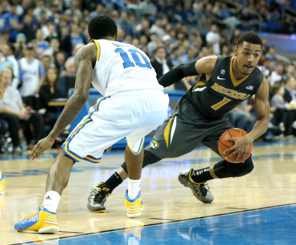 LOS ANGELES, CA - DECEMBER 28:  Phil Pressley #1 of the Missouri Tigers drives around Larry Drew II #10 of the UCLA Bruins at Pauley Pavilion on December 28, 2012 in Los Angeles, California.  (Photo by Stephen Dunn/Getty Images)