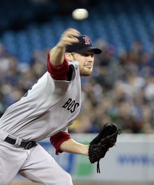 TORONTO, CANADA - JUNE 3: Daniel Bard #51 of the Boston Red Sox throw a pitch against the Toronto Blue Jays during MLB action at The Rogers Centre June 3, 2012 in Toronto, Ontario, Canada. (Photo by Abelimages/Getty Images)