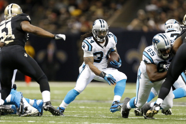 NEW ORLEANS, LA - DECEMBER 30:  DeAngelo Williams #34 of the Carolina Panthers runs the ball against  the New Orleans Saints at Mercedes-Benz Superdome on December 30, 2012 in New Orleans, Louisiana.  The Panthers defeated the Saints 44-38.  (Photo by Wesley Hitt/Getty Images)