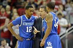 Dec 29, 2012; Louisville, KY, USA;  Kentucky Wildcats head coach John Calipari talks with guard Ryan Harrow (12) and guard Julius Mays (34) during the first half against the Louisville Cardinals at the KFC Yum! Center.   Mandatory Credit: Jamie Rhodes-USA TODAY Sports