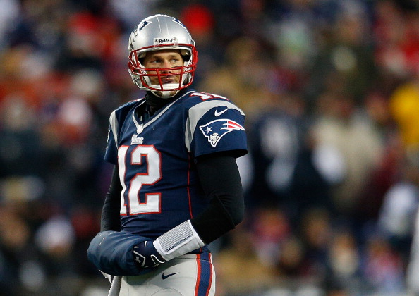 FOXBORO, MA - DECEMBER 30: Tom Brady #12 of the New England Patriots walks to the sideline during a game with the Miami Dolphins at Gillette Stadium in the second quarter on December 30, 2012 in Foxboro, Massachusetts. (Photo by Jim Rogash/Getty Images)