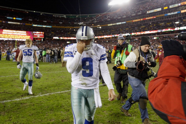 LANDOVER, MD - DECEMBER 30:  Quarterback Tony Romo #9 of the Dallas Cowboys walks off the field following the Cowboys 28-18 loss to the Washington Redskins at FedExField on December 30, 2012 in Landover, Maryland.  (Photo by Rob Carr/Getty Images)