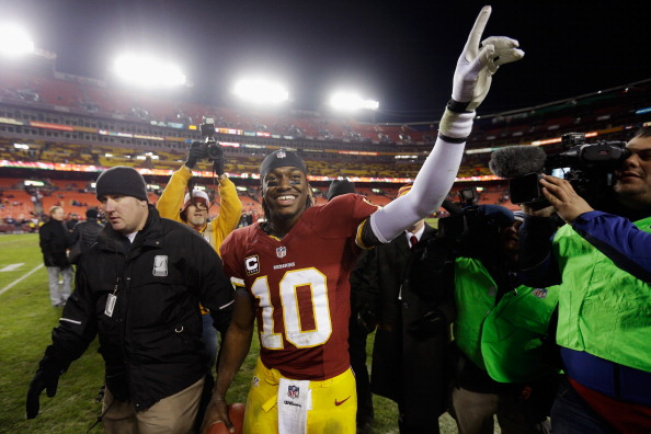 LANDOVER, MD - DECEMBER 30:  Quarterback Robert Griffin III #10 of the Washington Redskins celebrates after the Redskins defeated the Dallas Cowboys 28-18 at FedExField on December 30, 2012 in Landover, Maryland.  (Photo by Rob Carr/Getty Images)