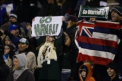 Nov 16, 2012; Colorado Springs, CO, USA; Hawaii Warriors fans react to the early score by tight end Clark Evans (not pictured) in the first quarter of the game against the Air Force Falcons at Falcon Stadium. Mandatory Credit: Ron Chenoy-USA TODAY Sports