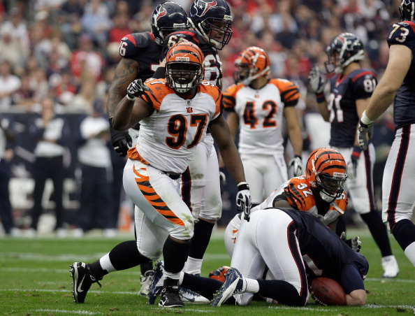 HOUSTON, TX - JANUARY 07:  Geno Atkins #97 of the Cincinnati Bengals celebrates after he sacked T.J. Yates #13 of the Houston Texans in the first half during their 2012 AFC Wild Card Playoff game at Reliant Stadium on January 7, 2012 in Houston, Texas.  (Photo by Thomas B. Shea/Getty Images)