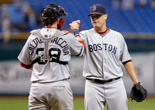 ST. PETERSBURG - SEPTEMBER 18:  Catcher Jarrod Saltalamacchia #39 of the Boston Red Sox congratulates pitcher Andrew Bailey #40 after his save against the Tampa Bay Rays at Tropicana Field on September 18, 2012 in St. Petersburg, Florida.  (Photo by J. Meric/Getty Images)