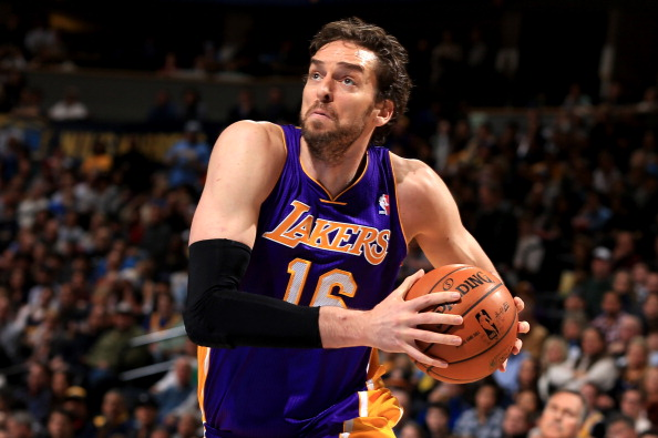 DENVER, CO - DECEMBER 26:  Pau Gasol #16 of the Los Angeles Lakers drives to the basket against the Denver Nuggets at Pepsi Center on December 26, 2012 in Denver, Colorado. NOTE TO USER: User expressly acknowledges and agrees that, by downloading and or using this photograph, User is consenting to the terms and conditions of the Getty Images License Agreement.  (Photo by Doug Pensinger/Getty Images)