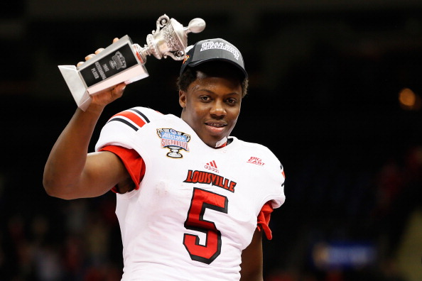 NEW ORLEANS, LA - JANUARY 02:  Teddy Bridgewater #5 of the Louisville Cardinals celebrates with the Most Outstanding Player award after their 33 to 23 win over the Florida Gators in the Allstate Sugar Bowl at Mercedes-Benz Superdome on January 2, 2013 in New Orleans, Louisiana.  (Photo by Kevin C. Cox/Getty Images)