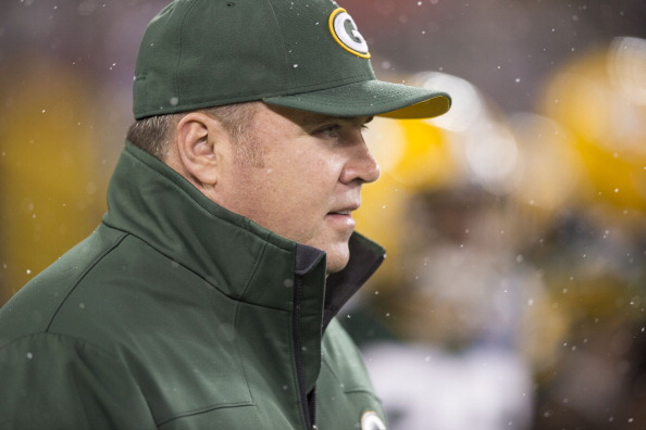 GREEN BAY, WI - December 9: Mike McCarthy head coach of the Green Bay Packers takes the field as snow falls before the start of the Detroit Lions v Green Bay Packers game at Lambeau Field on December 9, 2012 in Green Bay, Wisconsin. (Photo by Tom Lynn /Getty Images)