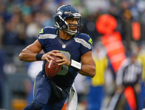SEATTLE, WA - DECEMBER 30:  Quarterback Russell Wilson #3 of the Seattle Seahawks rolls out to pass against the St. Louis Rams at CenturyLink Field on December 30, 2012 in Seattle, Washington. The Seahawks defeated the Rams 20-13.  (Photo by Otto Greule Jr/Getty Images)