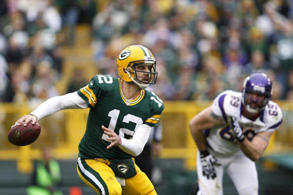 GREEN BAY, WI - DECEMBER 2: Aaron Rodgers #12 of the Green Bay Packers looks to pass the ball while under pressure from Jared Allen #69 of the Minnesota Vikings during the first half of the game at Lambeau Field on December 2, 2012 in Green Bay, Wisconsin. (Photo by Joe Robbins/Getty Images)