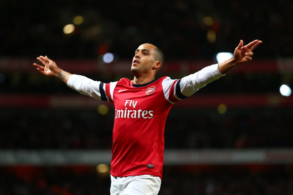 LONDON, ENGLAND - DECEMBER 29:  Theo Walcott of Arsenal celebrates scoring their fourth goal during the Barclays Premier League match between Arsenal and Newcastle United at the Emirates Stadium on December 29, 2012 in London, England.  (Photo by Clive Mason/Getty Images)