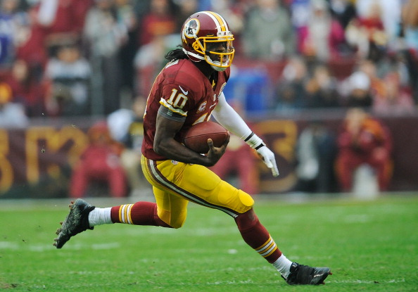 LANDOVER, MD - DECEMBER 09:  Robert Griffin III #10 of the Washington Redskins scrambles with the ball against the Baltimore Ravens in the second half during a game at FedExField on December 9, 2012 in Landover, Maryland.  (Photo by Patrick McDermott/Getty Images)