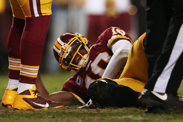 LANDOVER, MD - JANUARY 06:  Robert Griffin III #10 of the Washington Redskins is injured on a bad snap in the fourth quarter against the Seattle Seahawks during the NFC Wild Card Playoff Game at FedExField on January 6, 2013 in Landover, Maryland.  (Photo by Win McNamee/Getty Images)