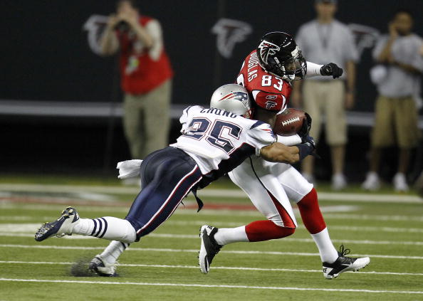 ATLANTA - AUGUST 19:  Wide receiver Harry Douglas #83 of the Atlanta Falcons is tackled by safety Patrick Chung #25 of the New England Patriots during the preseason game at the Georgia Dome on August 19, 2010 in Atlanta, Georgia.  (Photo by Mike Zarrilli/Getty Images)