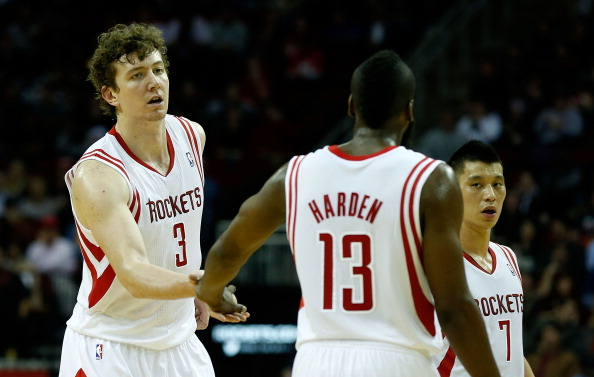 HOUSTON, TX - JANUARY 02:  Omer Asik #3 and James Harden #13 of the Houston Rockets celebrate a play against the New Orleans Hornets at Toyota Center on January 2, 2013 in Houston, Texas.  NOTE TO USER: User expressly acknowledges and agrees that, by downloading and or using this photograph, User is consenting to the terms and conditions of the Getty Images License Agreement.  (Photo by Scott Halleran/Getty Images)