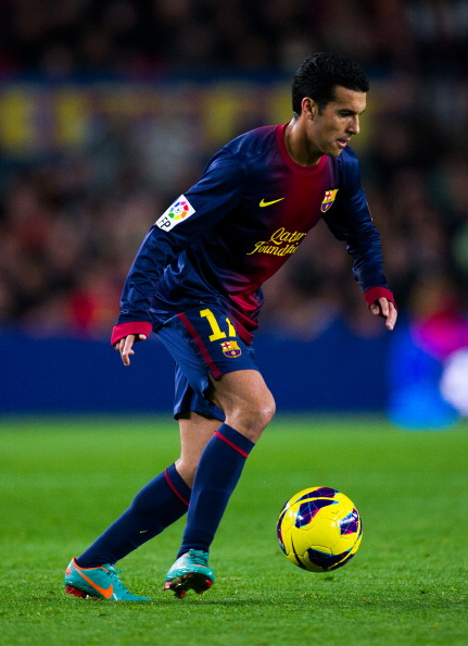 BARCELONA, SPAIN - JANUARY 06:  Pedro Rodriguez of FC Barcelona runs with the ball during the La Liga match between FC Barcelona and RCD Espanyol at Camp Nou on January 6, 2013 in Barcelona, Spain.  (Photo by David Ramos/Getty Images)
