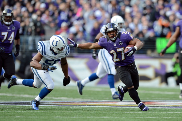 BALTIMORE, MD - JANUARY 06:  Ray Rice #27 of the Baltimore Ravens runs the ball against Jerrell Freeman #50 of the Indianapolis Colts during the AFC Wild Card Playoff Game at M&T Bank Stadium on January 6, 2013 in Baltimore, Maryland.  (Photo by Patrick Smith/Getty Images)