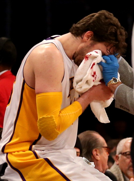 LOS ANGELES, CA - JANUARY 06:  Pau Gasol #16 of the Los Angeles Lakers receives treatment after being cut on the nose in the game against the Denver Nuggets at Staples Center on January 6, 2013 in Los Angeles, California.  The Nuggets won 112-105.  NOTE TO USER: User expressly acknowledges and agrees that, by downloading and or using this photograph, User is consenting to the terms and conditions of the Getty Images License Agreement.  (Photo by Stephen Dunn/Getty Images)