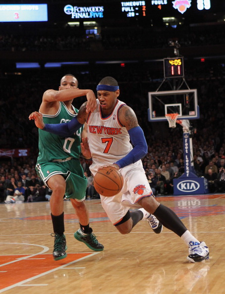 NEW YORK, NY - JANUARY 07:  Carmelo Anthony #7 of the New York Knicks dribbles the ball against the Boston Celtics at Madison Square Garden on January 7, 2013 in New York City. NOTE TO USER: User expressly acknowledges and agrees that, by downloading and/or using this photograph, user is consenting to the terms and conditions of the Getty Images License Agreement.  The Celtics defeated the Knicks 102-96.  (Photo by Bruce Bennett/Getty Images)