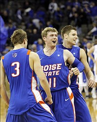 Nov 28, 2012; Omaha, NE, USA; Boise State Broncos forward Anthony Drmic (3) and guard Jeff Elorriaga (11) and guard Igor Hadziomerovic (12) celebrate their 83-70 win over the Creighton Bluejays at the CenturyLink Center. Mandatory Credit: Matt Ryerson-USA TODAY Sports