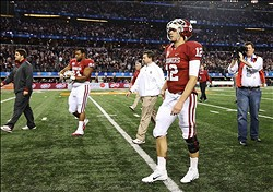 Jan 04, 2013; Arlington, TX, USA; Oklahoma Sooners quarterback Landry Jones (12) walks off the field after the loss against the Texas A&M Aggies in the 2013 Cotton Bowl at Cowboys Stadium. Mandatory Credit: Kevin Jairaj-USA TODAY Sports