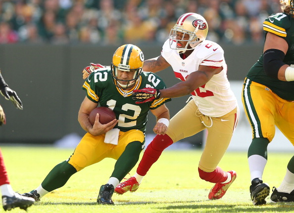 GREEN BAY, WI - SEPTEMBER 09:  Aaron Rodgers #12 of the Green Bay Packers is sacked by Carlos Rogers #22 of the San Francisco 49ers during the NFL season opener at Lambeau Field on September 9, 2012 in Green Bay, Wisconsin.  (Photo by Andy Lyons/Getty Images)
