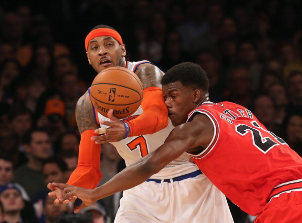 NEW YORK, NY - DECEMBER 21: Carmelo Anthony #7 of the New York Knicks and Jimmy Butler #21 of the Chicago Bulls battle for the ball at Madison Square Garden on December 21, 2012 in New York City. NOTE TO USER: User expressly acknowledges and agrees that, by downloading and/or using this photograph, user is consenting to the terms and conditions of the Getty Images License Agreement.  The Bulls defeated the Knicks 110-106. (Photo by Bruce Bennett/Getty Images)