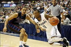 Jan 08, 2013; Storrs, CT, USA; Connecticut Huskies guard Ryan Boatright (11) drives against DePaul Blue Demons guard Brandon Young (20) during the second half at Gampel Pavilion. UConn defeated DePaul 99-78. Mandatory Credit: David Butler II-USA TODAY Sports