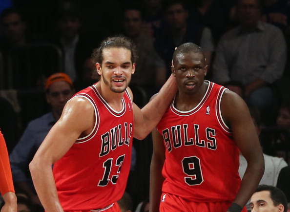 NEW YORK, NY - DECEMBER 21:  Joakim Noah #13 and Luol Deng #9 of the Chicago Bulls celebrate a basket against the New York Knicks at Madison Square Garden on December 21, 2012 in New York City. NOTE TO USER: User expressly acknowledges and agrees that, by downloading and/or using this photograph, user is consenting to the terms and conditions of the Getty Images License Agreement. The Bulls defeated the Knicks 110-106.  (Photo by Bruce Bennett/Getty Images)