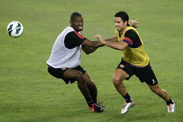 BEIJING, CHINA - JULY 26: Abou Diaby (L) and Mikel Arteta of Arsenal during a training session during the club's pre-season Asian tour at the Olympic Sports Centre on July 26, 2012 in Beijing, China..  (Photo by Lintao Zhang/Getty Images)