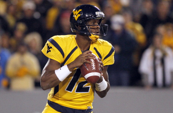MORGANTOWN, WV - NOVEMBER 17:  Geno Smith #12 of the West Virginia Mountaineers drops back to pass against the Oklahoma Sooners during the game on November 17, 2012 at Mountaineer Field in Morgantown, West Virginia.  (Photo by Justin K. Aller/Getty Images)
