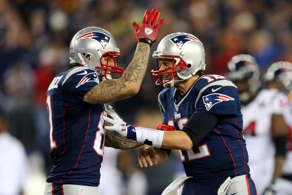 FOXBORO, MA - JANUARY 13:  Aaron Hernandez #81 and Tom Brady #12 of the New England Patriots celerbrate after a touchdown in the fourth quarter against the Houston Texans during the 2013 AFC Divisional Playoffs game at Gillette Stadium on January 13, 2013 in Foxboro, Massachusetts.  (Photo by Elsa/Getty Images)