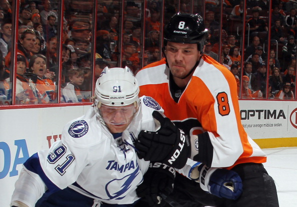 PHILADELPHIA, PA - MARCH 26: Nicklas Grossmann #8 of the Philadelphia Flyers hangs on to Steven Stamkos #91 of the Tampa Bay Lightning at the Wells Fargo Center on March 26, 2012 in Philadelphia, Pennsylvania.  (Photo by Bruce Bennett/Getty Images)