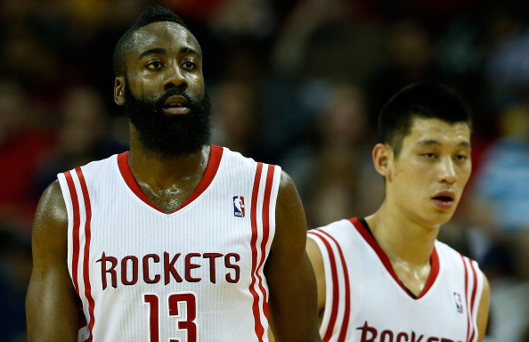 HOUSTON, TX - NOVEMBER 23:  James Harden #13 and Jeremy Lin #7 of the Houston Rockets wait for a play against the New York Knicks at the Toyota Center on November 23, 2012 in Houston, Texas. NOTE TO USER: User expressly acknowledges and agrees that, bagainst the Newy downloading and or using this photograph, User is consenting to the terms and conditions of the Getty Images License Agreement.  (Photo by Scott Halleran/Getty Images)