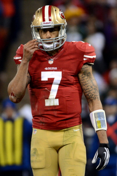 SAN FRANCISCO, CA - JANUARY 12:  Quarterback Colin Kaepernick #7 of the San Francisco 49ers looks on against the Green Bay Packers during the NFC Divisional Playoff Game at Candlestick Park on January 12, 2013 in San Francisco, California.  (Photo by Harry How/Getty Images)
