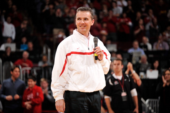 COLUMBUS, OH - JANUARY 15:  Head football coach Urban Meyer of the Ohio State Buckeyes is introduced to the crowd at halftime of the basketball game between the Indiana Hoosiers and the Ohio State Buckeyes on January 15, 2012 at Value City Arena in Columbus, Ohio.  (Photo by Jamie Sabau/Getty Images)