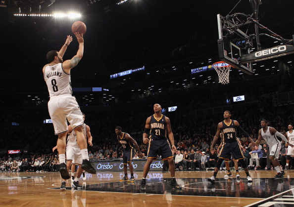 NEW YORK, NY - JANUARY 13: Deron Williams #8 of the Brooklyn Nets takes the shot against the Indiana Pacers at the Barclays Center on January 13, 2013 in New York City. NOTE TO USER: User expressly acknowledges and agrees that, by downloading and/or using this photograph, user is consenting to the terms and conditions of the Getty Images License Agreement.  (Photo by Bruce Bennett/Getty Images)