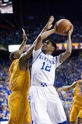 Jan 15, 2013; Lexington, KY, USA; Kentucky Wildcats guard Ryan Harrow (12) shoots the ball against Tennessee Volunteers guard Josh Richardson (1) in the first half of the game at Rupp Arena. Mandatory Credit: Mark Zerof-USA TODAY Sports