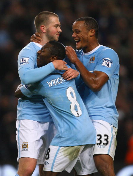 MANCHESTER, ENGLAND - OCTOBER 28:  Michael Johnson of Manchester City celebrates with Vincent Kompany and Shaun Wright-Phillips after scoring his goal during the Carling Cup 4th Round match between Manchester City and Scunthorpe United at the City of Manchester Stadium on October 28, 2009 in Manchester, England.  (Photo by Alex Livesey/Getty Images)