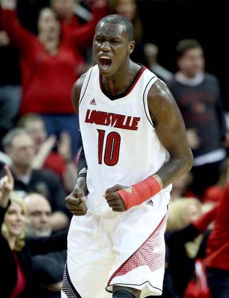 LOUISVILLE, KY - DECEMBER 29:  Gorgui Dieng #10 of the Louisville Cardinals celebrates during the game against the Kentucky Wildcats at KFC YUM! Center on December 29, 2012 in Louisville, Kentucky. Louisville won 80-77.  (Photo by Andy Lyons/Getty Images)